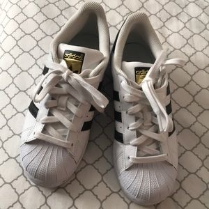 Adidas work once. Kids size 4